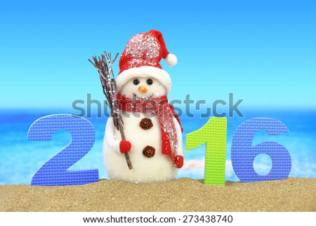 New year number 2016 and snowman on the beach - stock photo