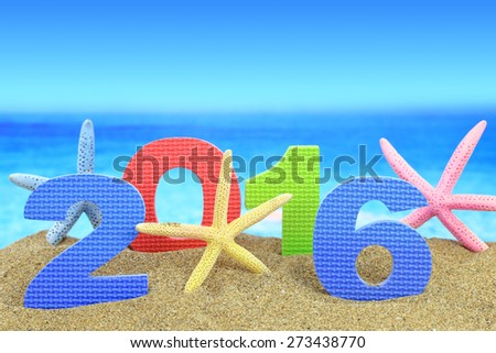 New year number 2016 and starfishes on the beach - stock photo