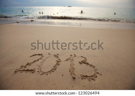 New Year 2013. Numbers 2013 written in a sandy beach - stock photo