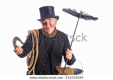 New Year photo of a chimney sweep wishing good fortune with a horseshoe - stock photo