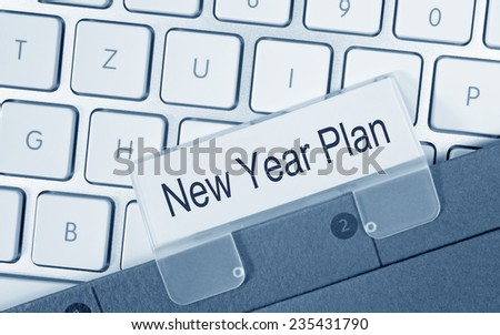 New Year Plan - folder on keyboard in the office - stock photo