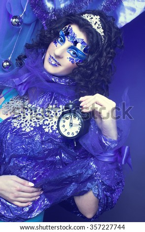 New Year. Portrait of young brunette in creative carnival image.