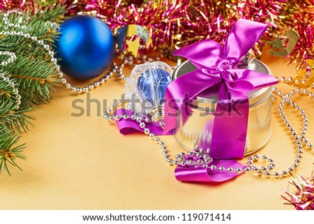 New Year present and decorations on yellow background