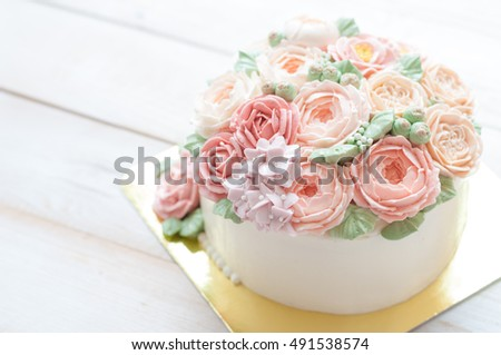 New year present concept buttercream flower cake on wood table.