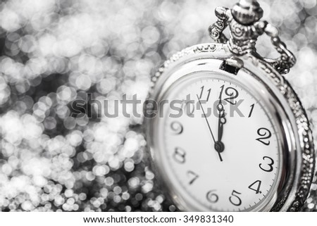 New Year's at midnight - Old clock and holiday lights - stock photo