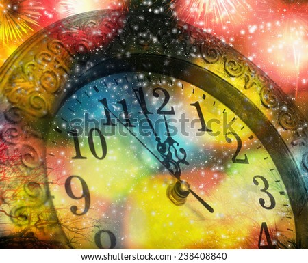 New Year's at midnight - old clock on colorful bokeh background - stock photo