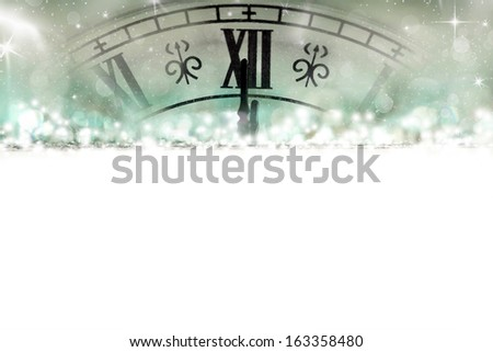 New Year's at midnight - Old clock with stars and snowflakes - stock photo