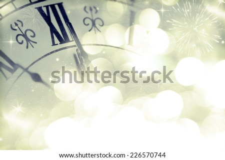 New Year's at midnight - Old clock with stars, snowflakes and holiday lights - stock photo