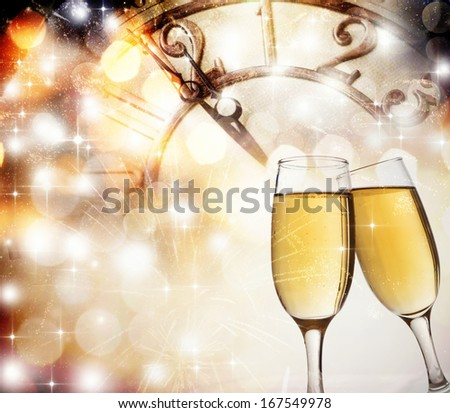 New Year's at midnight with champagne glasses and clock on light background - stock photo