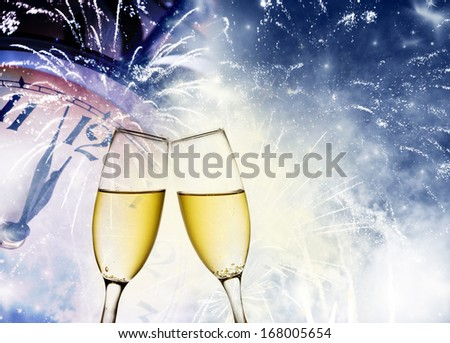 New Year's at midnight with champagne glasses, fireworks and clock on light background - stock photo