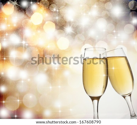 New Year's at midnight with champagne glasses on light background - stock photo
