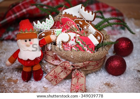 New Year's bag with gifts. Gingerbread ornaments on a Christmas tree. Delicious Christmas gifts. Santa Claus with a bag of gifts. - stock photo