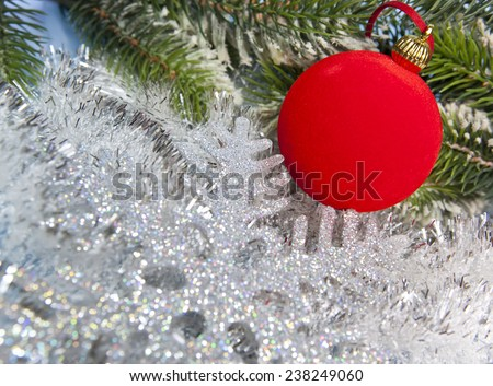 New Year's ball and decorative snowflake - stock photo