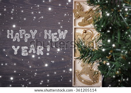 New Year's card with Christmas-tree decorations and caramel, the top view. A blank space for your text. Happy New year!