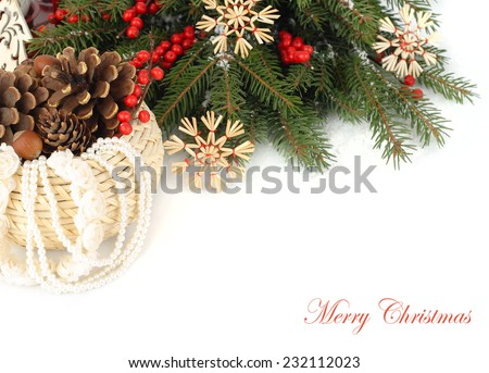 New Year's composition with straw snowflakes and red berries   on a white background.