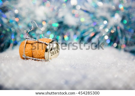 New Year's Eve/Champagne cork  in the snow new year's 2018