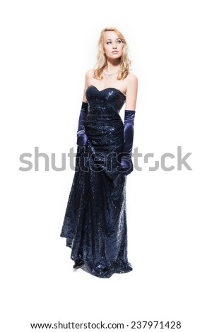 New year's eve fashion woman with blonde hair wearing dark blue dinner dress. Isolated against white. - stock photo