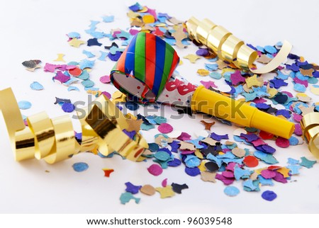 New Year's Eve noisemaker and party confetti - stock photo