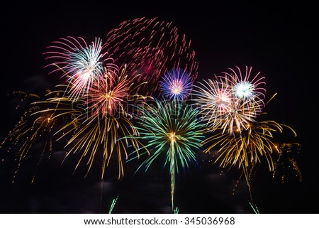 New Year's fireworks celebration of the old year and the new year.  - stock photo