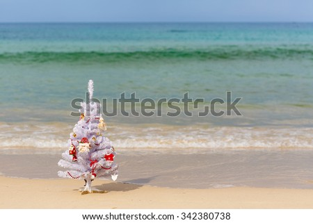 New Year's landscape, the sea, the decorated New Year tree on a beach, soft focus - stock photo