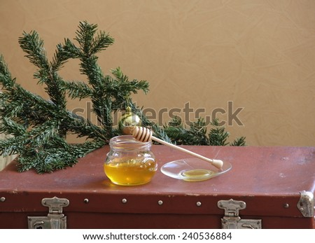 New Year's still-life with honey and a fur-tree branch