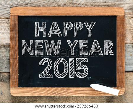 New year 2015 sign. New year 2015 sign. New year sign on chalkboard - stock photo