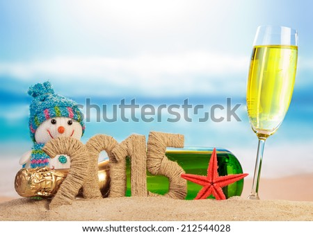 New year sign with champagne, snowman on the beach background - stock photo