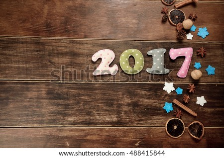 New year theme decoration figures of 2017 with spices on wooden table
