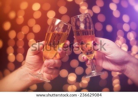 New year toast / two people make a toast with a champagne for a happy new year - stock photo