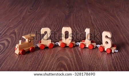 New year 2016 train on a wooden background - stock photo