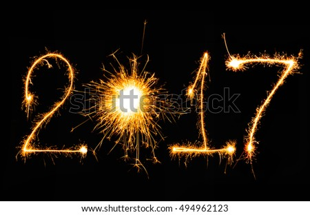New year 2017 writing sparkles firework with black background