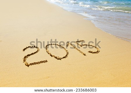 New year 2015 written on sand