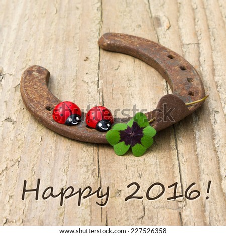 New Years Card with horseshoe, Leafed clover and ladybugs/Happy 2016/english - stock photo