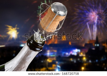 New Years celebration with bottle of champagne  - stock photo