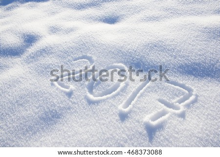 new years date 2017 written in fresh powder snow