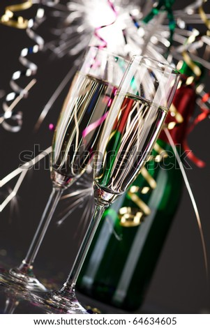 new years decoration with sparkling wine and fireworks - stock photo