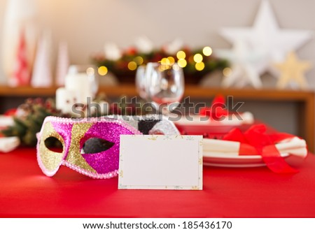 New Years dinner table setting with name card in red - stock photo