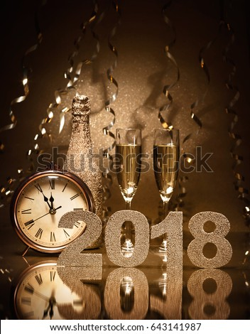 New Years Eve celebration background with pair of flutes, bottle of champagne and a clock