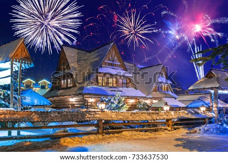 New Years firework display in Zakopane at snowy night, Poland