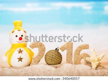 "New Years inscription ""2016"" with a snowman on the background of the sea"