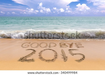 New Years 2016 is coming concept, Goodbye 2015 on the sand beach - stock photo