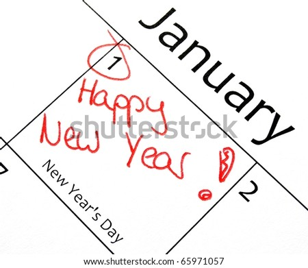 new years resolution writing with a red pen in a calendar - stock photo