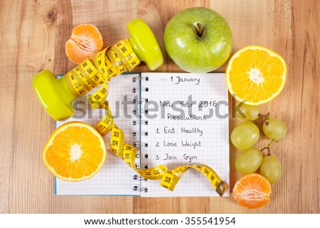 New years resolutions eat healthy, lose weight and join gym written in notebook, dumbbells for fitness with tape measure, concept of healthy lifestyle