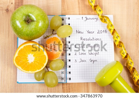 New years resolutions eat healthy, lose weight and join gym written in notebook, fresh fruits, dumbbells for fitness and tape measure, healthy lifestyle - stock photo