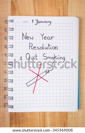 New years resolutions quit smoking written in notebook, concept of beginning of healthy lifestyle  - stock photo