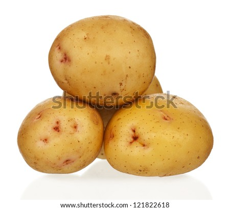 New yellow potatoes isolated on white background close up - stock photo