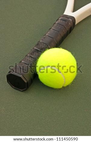 New yellow tennis balls on a green court - stock photo