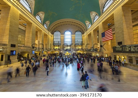 NEW YORK, AMERICA - APRIL 26, 2014: Commuters and tourists in the Grand Central Station main hall in New York. It is the largest train station in the world by number of platforms: 44, with 67 tracks.  - stock photo