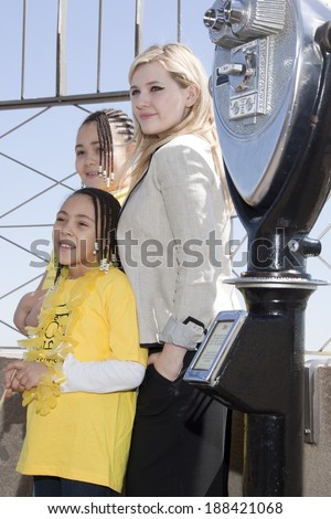 NEW YORK-APR 21, 2014: Actress & Project Sunshine Ambassador Abigail Breslin stands with unidentified children of Project Sunshine on the roof of the Empire State Building for Project Sunshine Month.