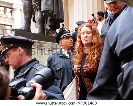 NEW YORK - APR 13: An unidentified Occupy Wall Street activist is arrested on the steps of Federal Hall on Wall Street April 13, 2012 in New York City, NY. - stock photo